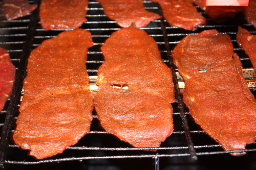 We smoke/dry the beef jerky in a smokehouse.  Here is photo of the jerky laying on screens in the smokehouse.  Click on the photo to enlarge.